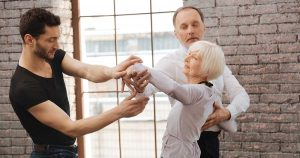 Elderly woman in dance lesson